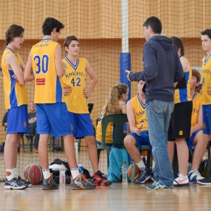Players with coach during time-out
